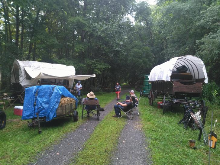 A wagon train camping on the Greenbrier River Trail